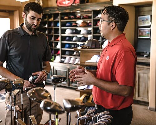 explaining-golf-clubs-indoors-men